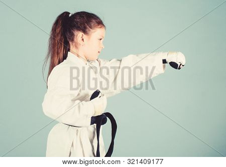 Sport Success In Single Combat. Practicing Kung Fu. Happy Childhood. Little Girl In Gi Sportswear. S