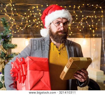 Spirit Of Winter Miracle. Post For Santa Claus. Man Bearded Hipster Wear Santa Hat Hold Bunch Of Let
