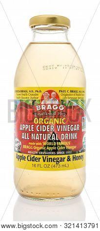 Winneconne, Wi - 10 September 2019: A Bottle Of Bragg Apple Cider Vinegar Drink With Honey On An Iso