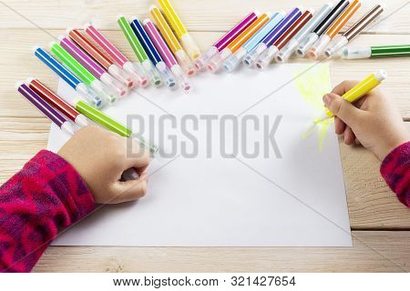 A Child Draws A Birthday Card. Drawing Made By A Child With Colorful Felt-tip Pens. A Happy Family.