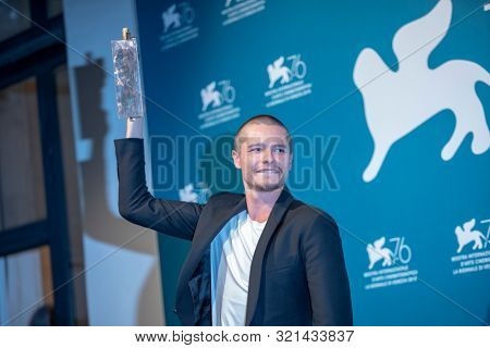 Toby Wallace poses with the Marcello Mastroianni Award for Best Young Actor for