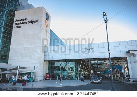 Exterior View Of Lisbon International Airport Where Travelers Walk