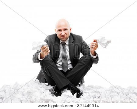 Business problems and failure at work concept - unhappy tired or stressed businessman sitting in depression hand holding crumpled torn paper document white isolated