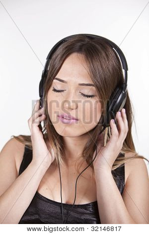 Beautiful Cheerful Young Woman Enjoying Music