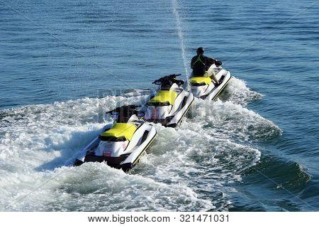 Jetski Towing Jetskis To A Rental Location On The Florida Intra-coastal Waterway Off Miami Beach