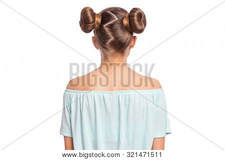 Rear view of teen girl with funny hairstyle, isolated on white background. Portrait of caucasian child - back view.