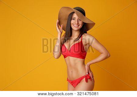 Pretty Sexy Woman With Slim Body In Stylish Red Bikini On Orange Background, Space For Text