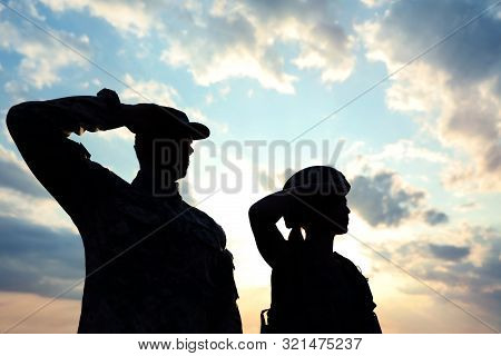 Soldiers In Uniform Saluting Outdoors. Military Service