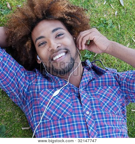 Young African American Male Lying In Grass