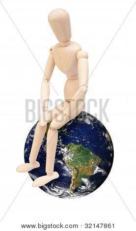 Wooden Puppet On Globe