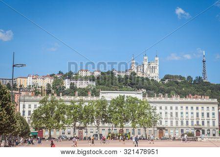 Lyon, France - July 14, 2019:  Basilique Notre Dame De Fourviere Church Seen From The Place Bellecou