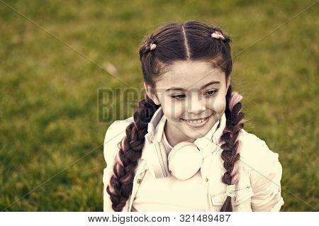 Little Girl Listen Music. Kid In Headphones. Spring Mood. Mp3 Player. Stylish Child Relax On Grass.