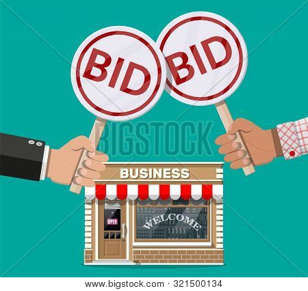 Hands Holding Auction Paddle. Bid Plate. Real Estate, House Building Shop Or Commercial Property. Au