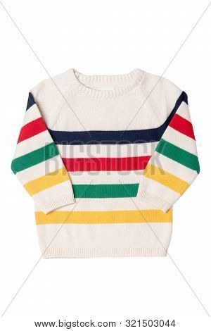 Autumn And Winter Children Clothes. Close-up Of Colorful Striped Cozy Warm Sweater Or Pullover Isola