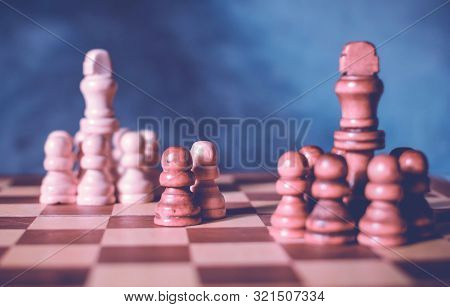 Diplomacy And Conversation Concept. Diplomatic Negotiations Idea With Two Teams Of Chess And One Rep
