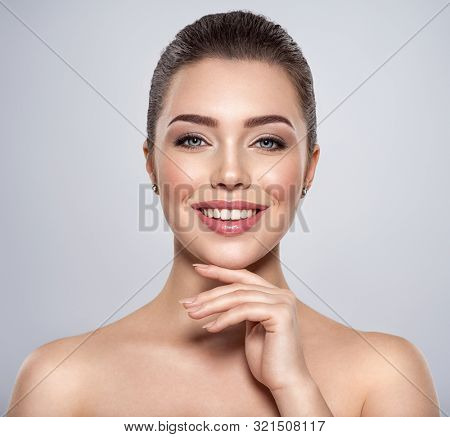 Front portrait of the smiling woman with beauty face - isolated. Beauty face of the young beautiful girl  with a  healthy skin.  Skin care concept.