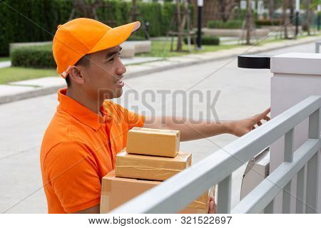 Delivery man ring a bell to call customers for receive a parcel at front home poster