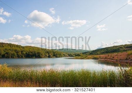 Coastal Summer Landscape. Small Lake In Crimean Mountains At Sunny Summer Day Under Cloudy Sky