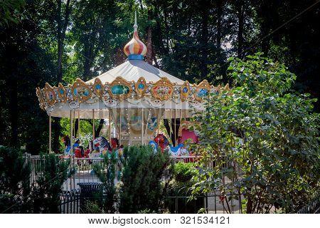 Carousel For Children In Bernardinai Garden In Vilnius