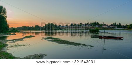 Wooden Riverboats Ona Calm Loire River At Sunset In The French Countryside Near Orleans