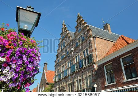 The City Hall (stadhuis, Built In 1601) With Colorful Flowers In The Foreground, Naarden, Netherland