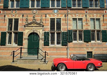 Naarden, Netherlands - August 24, 2019: The City Hall (stadhuis, Built In 1601), With A Vintage Car