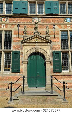 Close-up On The Entrance Of The City Hall (stadhuis, Built In 1601), With Carvings, Naarden, Netherl