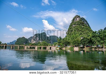 River Landscape And Picturesque Yangshuo Village With Green Mountain Ranges. Guilin, China.
