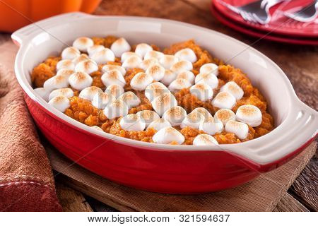 A Delicious Homemade Sweet Potato Casserole With Marshmallow Topping.