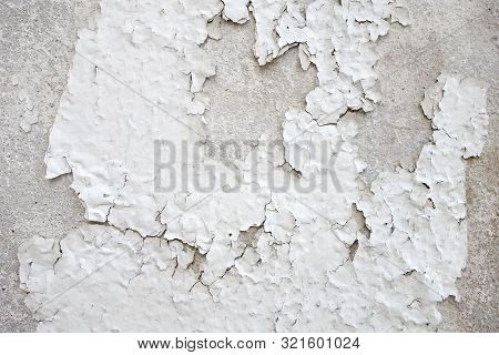 Close Up Detail Of Old Damaged White Concrete Wall Or Floor Texture, Cracked Dry Paint And Peeling O