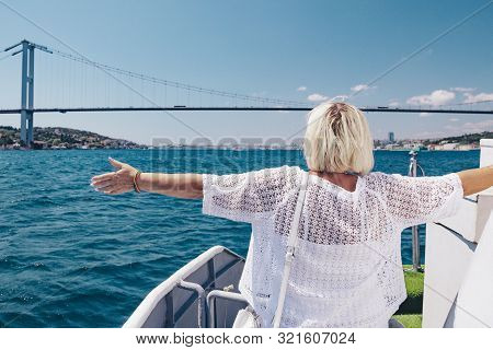 Smiling Attractive Woman In Sunglasses On The Big White Ship Or Yacht. Cruise, Travel And Adventure
