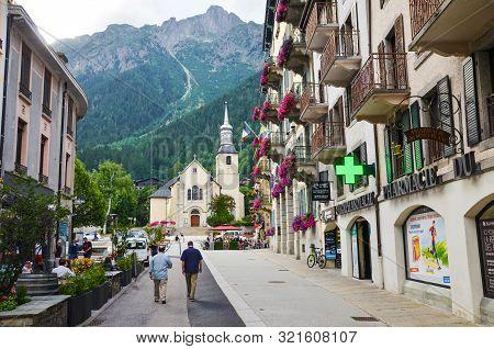 Chamonix, France - July 30, 2019: Street In Alpine Village Chamonix Photographed In Summer With Peop