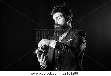 Servant carry metallic cloche. Man well groomed gentleman formal suit hold little cloche. Serving and presentation. Elite luxurious. Secret under cloche. Exclusive food hidden cloche. Butler concept poster