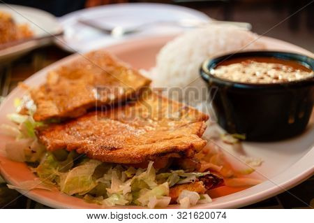 A Steak Jibarito Sandwich With White Rice And Beans On The Side. Puerto Rican Food Cuisine.
