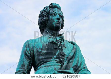 Mozart Monument On Mozartplatz Square At Salzburg