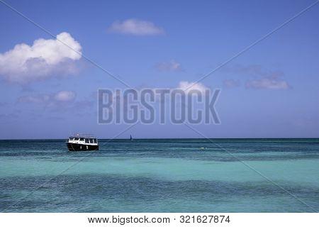 The Serene Blue Water Of The Caribbean Sea In Aruba