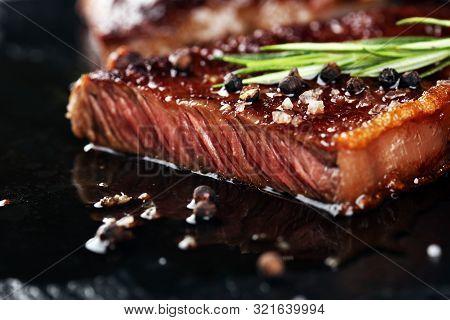 Barbecue Rib Eye Steak Or Rump Steak - Dry Aged Wagyu Entrecote Steak On Rustic Background