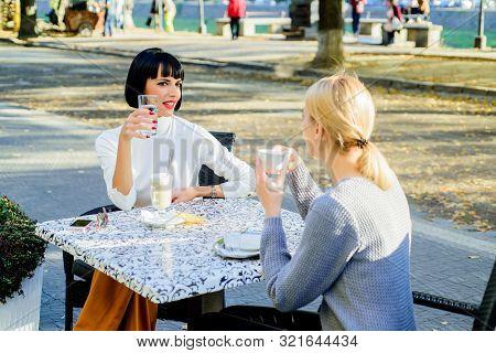 Togetherness Female Friendship. Trustful Communication. Girls Friends Drink Coffee And Enjoy Talk. T