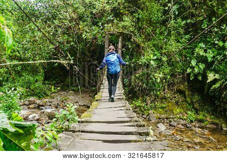 View On Girl On Bridge Over River In Cocora Valley, Colombia