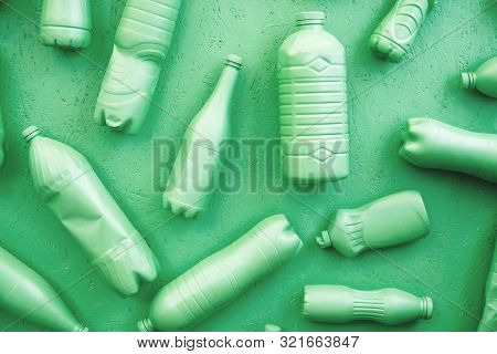 Plastic Bottles In Mint Color. Eco Concept. All Bottles Are In One Color.