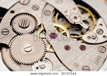 gears and mainspring in the mechanism of a pocket watch poster