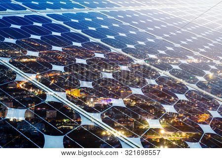 Texture Of Photovoltaic Panels Solar Panel With City Night Light Background, Alternative Energy Conc