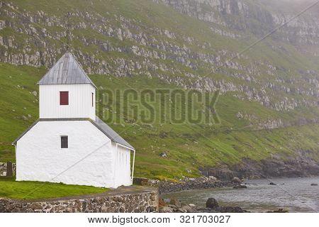 Traditional Feroe White Stone Church In Kirkjubour. Feroe Cultural Heritage
