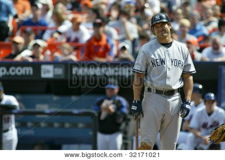 NEW YORK - MAY 20: Johnny Damon #18 of the New York Yankees grimaces at a call as he plays against the New York Mets on May 20, 2006 at Shea Stadium in Flushing, New York.