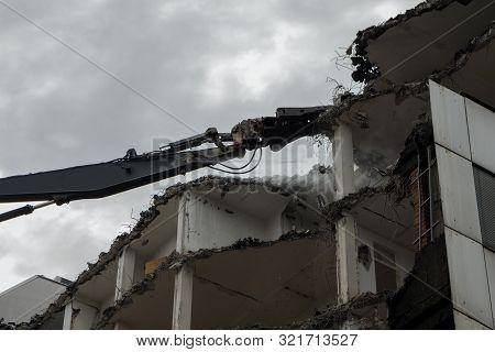 Demolition Pulveriser Demoliting Building In The City
