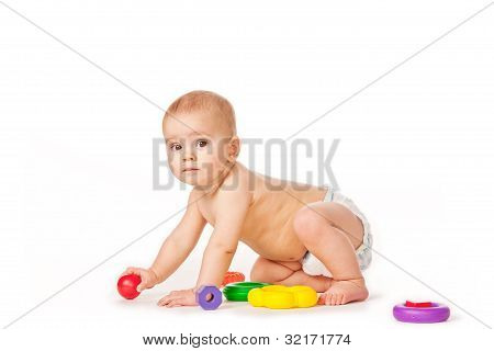 Small child play with toys on white background