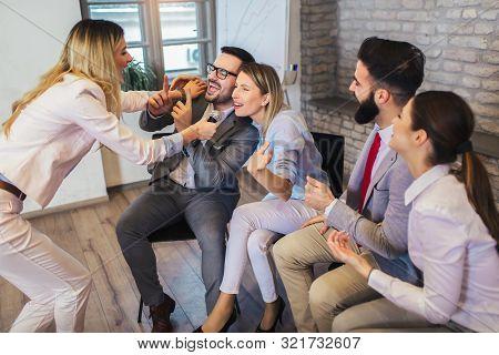 Business People Making Team Training Exercise During Team Building Seminar Singing Karaoke. Indoor T