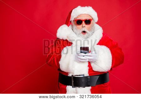 Portrait Of Impressed Christmas Father In Hat Using Cell Phone Device Screaming Omg Wearing Read Abo