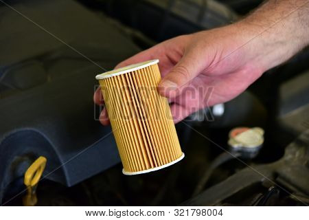 Repairman Holding An New Car Oil Filter