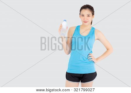 Beautiful young asian woman in sport after workout drinking water from bottle for thirsty isolated on white background, asia girl after exercise drink water for hydration and refresh with healthy. poster